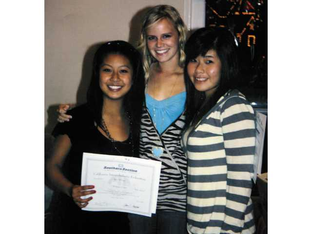 Former Hart tennis player Kari Hsieh, right, is shown here with doubles partner Stacy Wuang, left, and Emily Van Houdt. The Indians are moving on more than a month after Hsieh died in the Metrolink crash in Chatsworth.