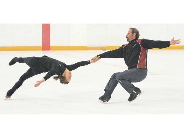 "Two-time Olympic Gold Medalist Lloyd Eisler, right, and partner Choeleen Loundagin practice a figure skating stunt called a ""death spiral"" at Valencia Ice Station. Eisler is married to film and TV actress Kristy Swanson, who is probably best known for her role in the 1992 film ""Buffy the Vampire Slayer."" Eisler and Swanson married in February and moved to Santa Clarita with their 2-year-old son Magnus Hart Swanson Eisler in June."