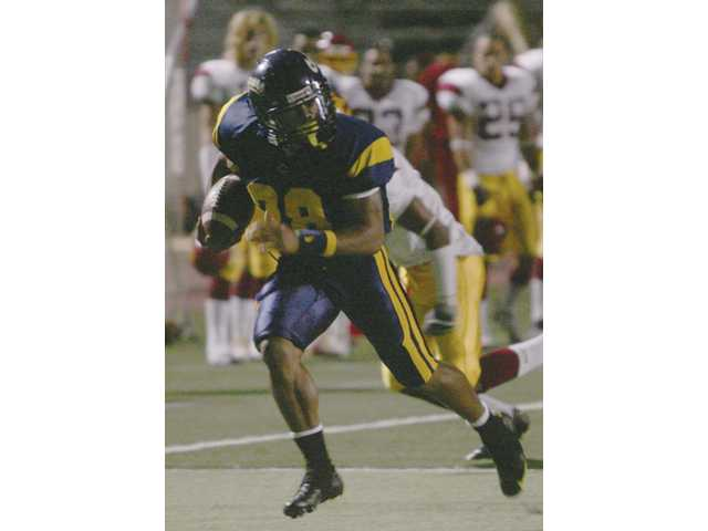 College of the Canyons running back Anthony Johnson runs for a touchdown in the first half of the Cougars' 14-6 victory over Glendale College on Saturday at Cougar Stadium.