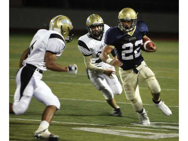 West Ranch High School Running Back Trent Yokofich powers through Golden Valley defense in the first quarter on Friday.