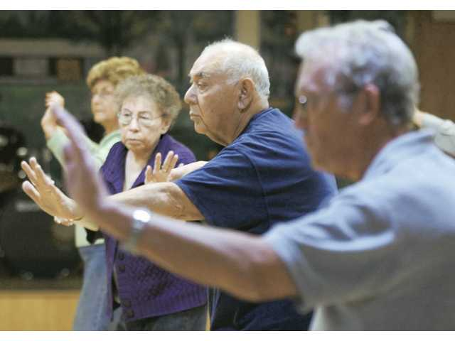 Sylmar resident Ruben Vargas, second from right, participates in the Tai Chi Chuan classes at the Santa Clarita Valley Senior Center on Thursday.
