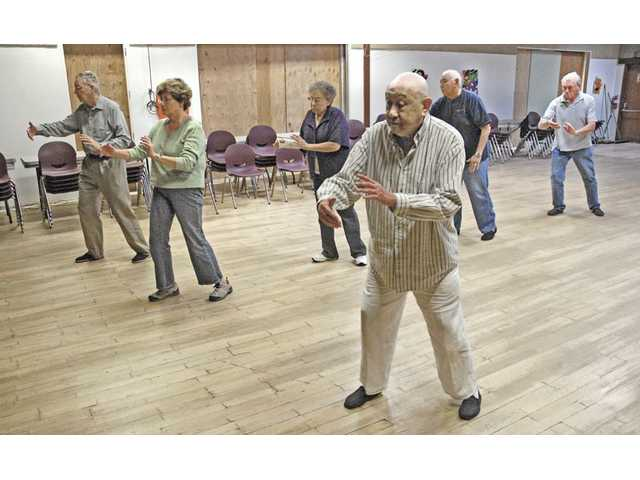 C.C. Chang, foreground right, leads a group of seniors through an hour of gentle, Tai Chi Chuan exercises. With its gentle movements, Tai Chi Chuan is an ideal exercise for seniors, according to Chang.