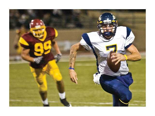College of the Canyons quarterback Brad McClellan is on the run Saturday against Glendale College.