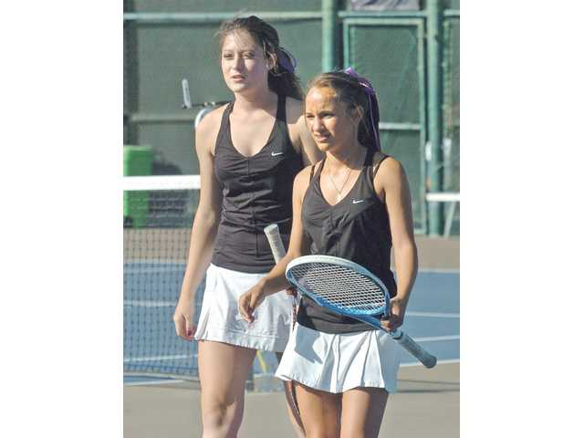 Valencia's No. 1 doubles team of Chelsie Dietz, left, and Andrea Zammit had to wait awhile before they got to play together for the Vikings, but they've become a doubles force in the Foothill League.