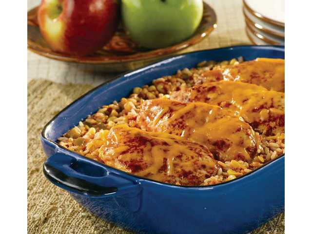 Picante Chicken & Rice BakePrep Time: 10 minutesBake Time: 45 minutesMakes: 4 servings 1  jar (16 ounces) Pace Picante sauce 1/2  cup water 1  cup whole kernel corn 3/4  cup uncooked regular long-grain white rice 4  skinless, boneless chicken breast halves Paprika 1/2  cup shredded cheddar cheese1. Stir picante sauce, water, corn and rice in an 11 x 8-inch shallow baking dish. Top with the chicken. Sprinkle the chicken with the paprika. Cover the dish.2. Bake at 375°F for 45 minutes or until chicken is cooked through and rice is tender. Sprinkle with cheese.