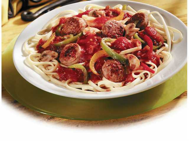Spicy Sausages & LinguinePrep Time: 10 minutesCook Time: 40 minutesMakes: 4 servings 2  tablespoons olive oil 2  cloves garlic, minced 10  small pork sausage links, cut up 1/4  teaspoon dried Italian    seasoning, crushed 1  jar (24 ounces) Pace Picante sauce 3  peppers, sliced 1  medium onion, sliced 8  ounces fresh mushrooms, sliced 1  package (16 ounces) linguine, cooked and drained  Grated Parmesan cheese1. Heat oil in 10-inch skillet over medium-high heat. Add garlic, sausage and Italian seasoning. Cook until sausages are browned and cooked through.2. Add picante sauce, peppers, onion and mushrooms. Heat to a boil. Cover. Reduce heat to low.3. Cook for 25 minutes or until the vegetables are tender. Serve over linguine and top with cheese.