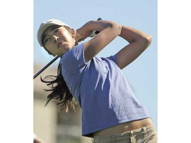 Valencia's Alison Lee tees off on hole No. 2 at TPC Valencia on Tuesday. She shot a 2-under 34.