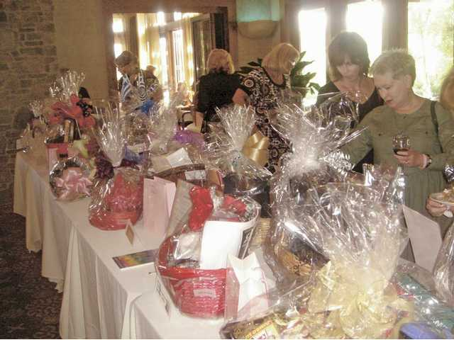 Guests to Bras for a Cause at the Tournament Players Club in Valencia bid on silent auction items.
