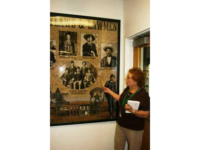 Estelle Foley shows visitors the start of her tour of the Santa Clarita Valley Sheriff's Station in May. She has been the station's official volunteer historian for a quarter-century as of Oct. 23, 2008.