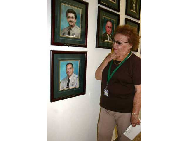 Estelle Foley, Santa Clarita Valley Sheriff's Station volunteer historian for a quarter-century as of Oct. 23, 2008, worked with Capt. Bob Spierer (top photo) when he was the station's unit commander, and now with Capt. Anthony LaBerge, unit commander since January 2007.