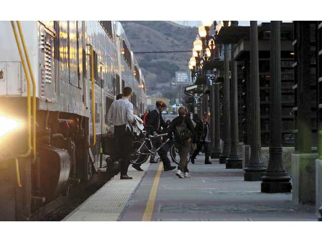 In this undated photo, passengers exit a commuter train at the Jan Heidt Metrolink Station in downtown Newhall.