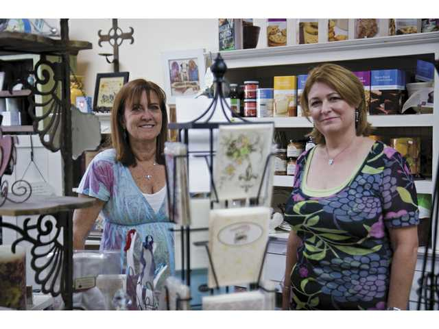 Beth Hatu and Nanette Ferrara, co-owners of McKenna & Greene in Saugus, will celebrate their store's second anniversary on Saturday.