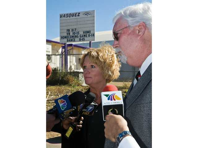 Principal Rosemary Oppenheim and Superintendent Stan Halperin speak to reporters outside of Vasquez High School.