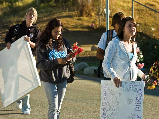 Students who helped to organized the memorial for Jeremiah Lasater enter Vasquez High Tuesday morning.