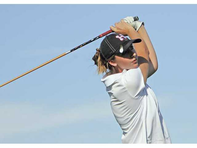 Hart's Nikki Prichard tees off on the ninth hole during the second day of the Newhall Land Cup Wednesday at TPC Valencia. Prichard was named the Foothill League MVP.