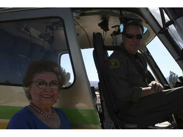 Estelle Foley meets Deputy Eric Allen, SCV Sheriff's Station helicopter pilot, before taking the first flight in her life.