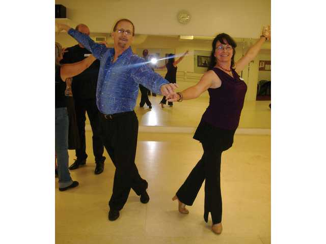 Wiley Simpson and Janet White strike a pose during a ballroom dancing class at Pamela Johnston's Dance Studio in Canyon Country. Simpson is kicking off regular lessons at the studio starting Tuesday.
