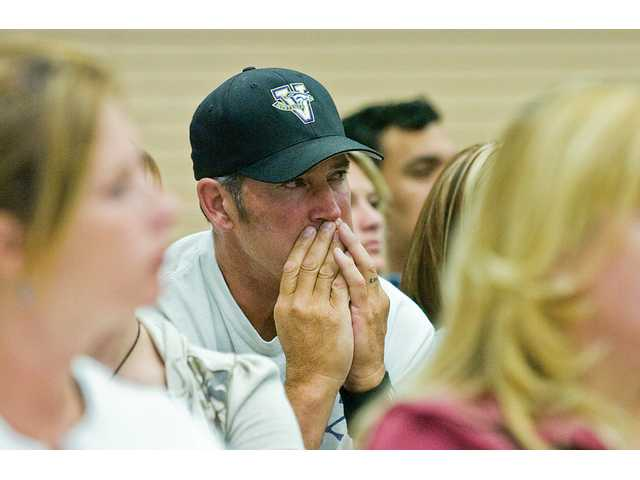 An Acton man listens to other members of the community speak at the Acton-Agua Dulce Unified School District Board of Trustees meeting Thursday night, to discuss the suicide of Vasquez High School freshman Jeremiah Lasater on Monday.