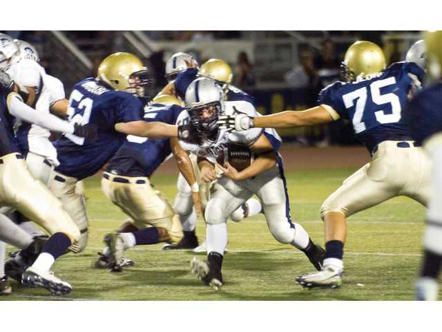 Saugus High running back Ryan Zirbel drives past the defensive line of West Ranch High in the second quarter.