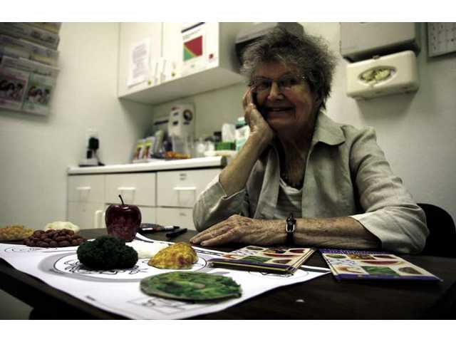 Betty Waldner assesses clients' eating habits at the Samuel Dixon Health Centers in Canyon Country and Val Verde.