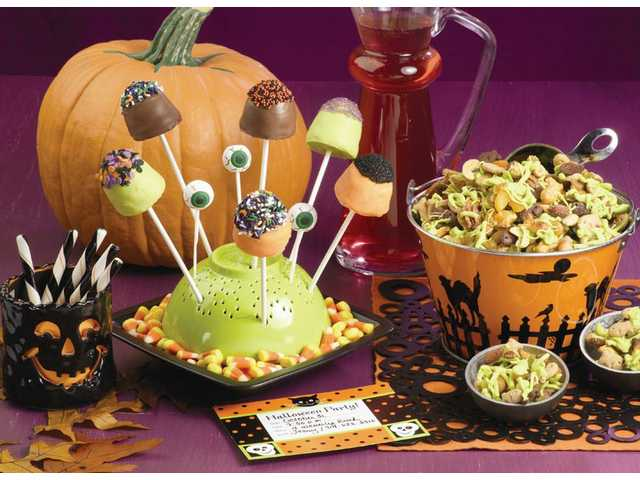 B-O-O Brownie PopsMakes 48 pops    1 package (about 16 ounces) brownie mix         (8 x 8-inch size)        Egg, water and oil to prepare mix    48 lollipop sticks        Wilton Orange, Spooky         Green and Light Cocoa Candy Melts        Wilton Spider Mix, Hallow  Pumpkin Mix, Halloween Nonpareil Sprinkles, and Orange, Black and Lavender Sugars, as desiredPreheat oven to 350°F. Spray brownie pop mold with vegetable pan spray; place on cookie sheet.Prepare brownie mix following package directions. Spoon batter into prepared brownie pop mold, filling cavities 2/3 full. Bake 15 min­utes. Remove mold from oven; insert lollipop sticks. Return to oven and continue baking 10 to 15 minutes or until brownies test done. Cool brownies in mold on cooling grid 20 minutes; remove from mold and cool completely. Melt each color candy following package instructions. Dip cooled pops into melted candy, covering completely. While the candy is still soft, sprinkle with or dip pops into sprinkles and sugars. Place on parchment paper to set. NOTE: If desired, bake brownies completely without inserting stick. After brownies have cooled, dip lollipop sticks into melted candy and insert into either end of brownie. Let set before decorating.Halloween Goldfish MunchMakes about 14 cups treat mix    3 packages (6.6 ounces each) Pepperidge Farm Cinnamon, Chocolate or Honey Goldfish Grahams (or any combination)    1 package (8 ounces) Pepperidge Farm Pretzel Goldfish Snack Crackers    1 can (10 ounces) salted mixed nuts    1 cup chopped dried apricots    1 cup golden raisins    2 packages (10 ounces each) Wilton Spooky Green Candy MeltsIn large bowl, combine crackers, nuts, apricots and raisins; divide between 2 large cookie pans. Melt candy following package directions; drizzle over snack mixture. Refrigerate until firm. Break apart and store in airtight container until ready to serve.