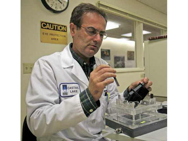 Senior Water Quality Scientist Majid Langroodi puts together an Electrolysis Reactor, a device that removes chemicals thought to cause cancer.