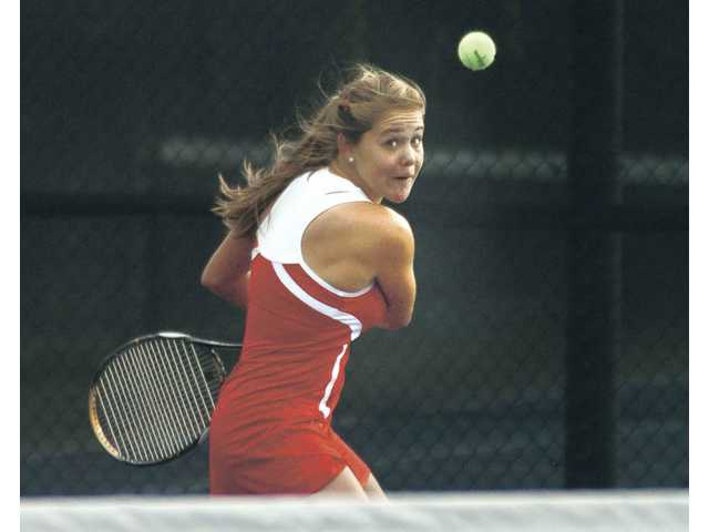 Hart No. 1 singles player Anne Susdorf returns a shot Tuesday at Valencia High. She won one set on the day.