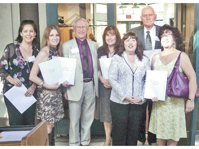 Artists who captured gold or silver awards for their art pose for a group photo with Laurie Morgan (second from right, front row) president of the Santa Clarita Artists' Association.