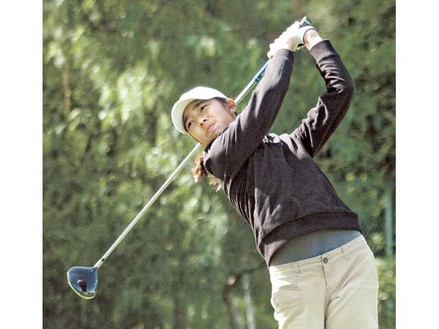 Valencia High freshman golfer Alison Lee tees off on the first hole Wednesday at Valencia Country Club in the Foothill Invitational.