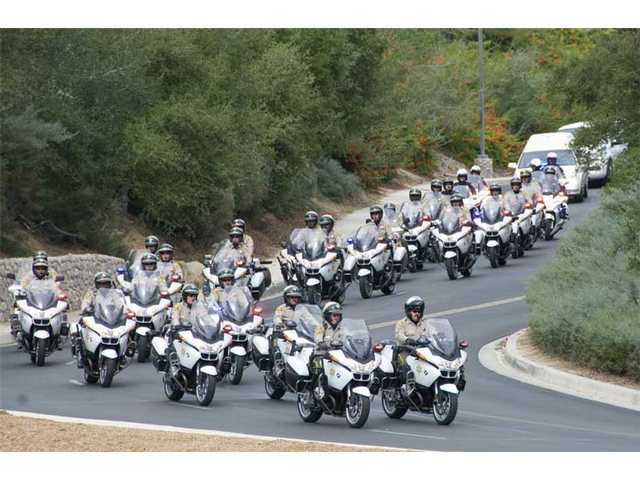The motorcycle motorcade.
