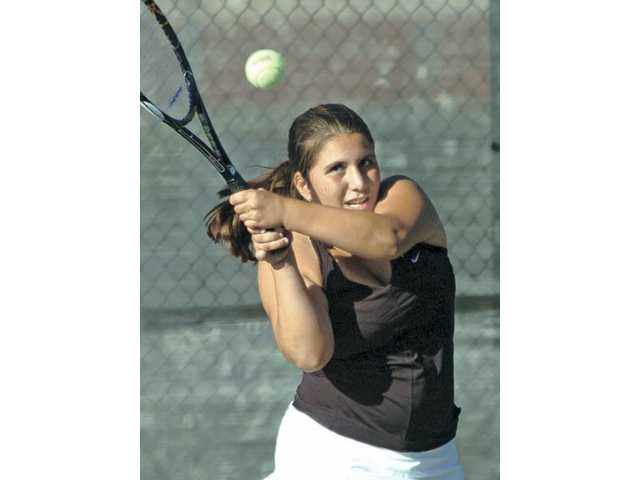 Valencia tennis player Shenelle Trujillo hits a tennis ball Thursday at Valencia High. Trujillo won two sets on the day.