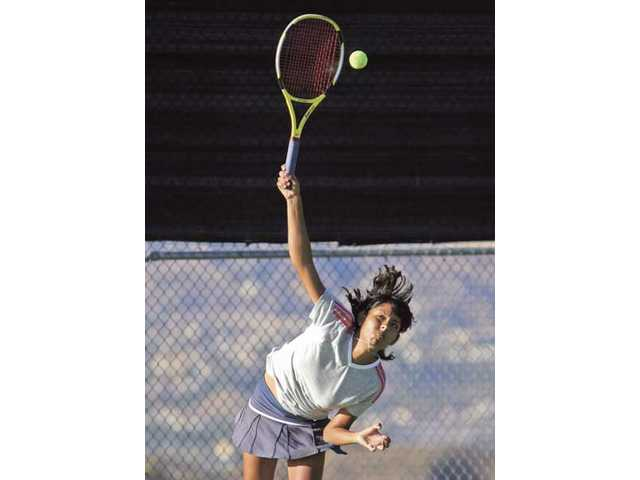 West Ranch tennis player Ana Lucia Fuentes serves during her third set against Canyon Thursday at West Ranch High.