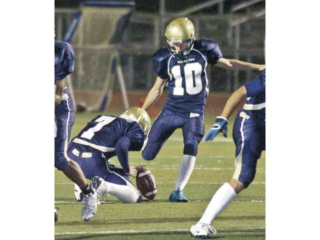 West Ranch kicker Brady Stuart (10) kicks his third field goal of the game Friday night against Canyon at Valencia High School.