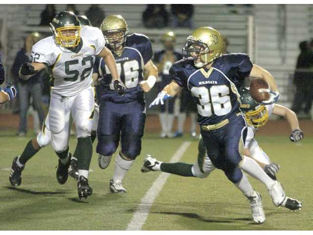 West Ranch's Zak Snell (36) runs the ball as teammate Nick Nowakowski (76) and Canyon's Benjamin Graham (52) chase Friday at Valencia High.