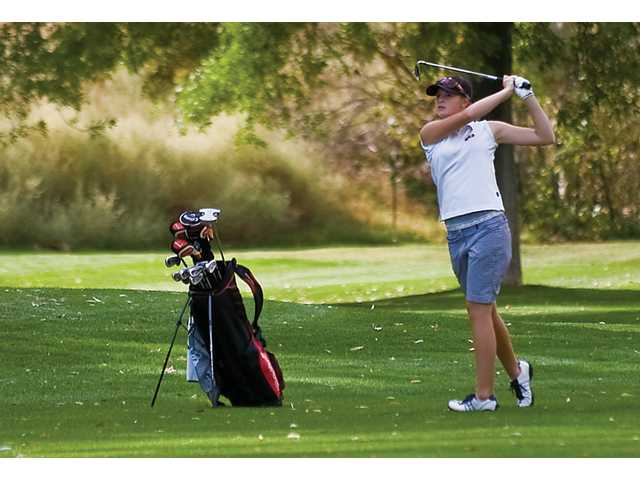Kendall Dusenberry from Hart High on the 13th hole hitting from the fairway at Valencia Country Club playing in the Foothill league individual finals.