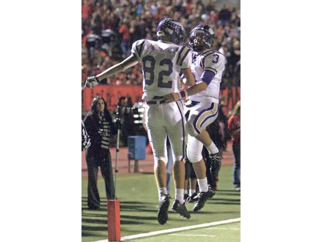 Valencia's Matt Nyberg (82) and Alex Bishop celebrate after a touchdown last Friday at College of the Canyons. Valencia beat Hart in the game 56-7.