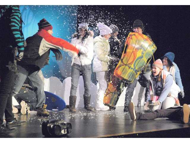 "Saugus High School students have a snowball fight during a blizzard as they present a play entitled ""Snow Angel"" for students at Arroyo Seco Junior High School."