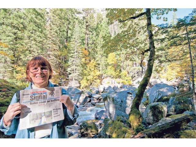 Zoe-Anne Fitzhugh stands on the edge of the Merced River just below Vernal Falls in Yosemite National Park in October. The photo was taken by her husband, Bruce McFarland.