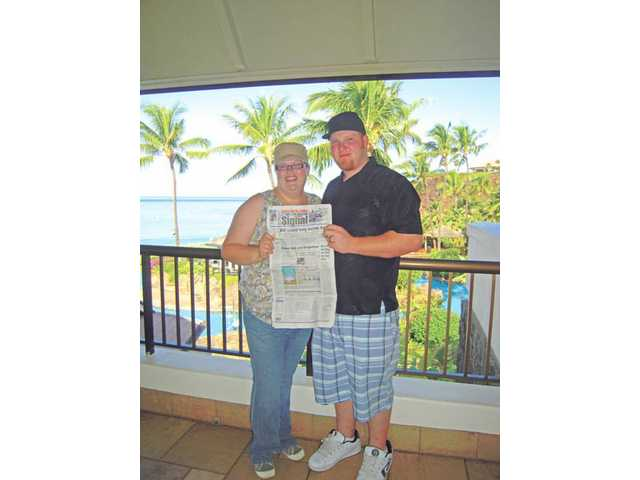 Devin and Elizabeth Mills took The Signal with them on their honeymoon to Maui, Hawaii in April. They stayed at the Sheraton hotel in Kaanapali, looking over Black Rock Beach.