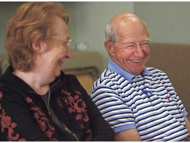 Jack, right, and Ginger Freed share some laughs Friday during the Live, Laugh, Love group at the Santa Clarita Valley Senior Center. The group meets once a week to socialize. According to a study in the July issue of the American Journal of Public Health, socializing is an important way to delay age-related memory loss.
