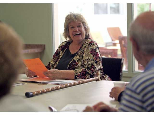 Live, Laugh, Love group director Lucy Reynolds-Hockett exchanges stories with participants for some laughs.
