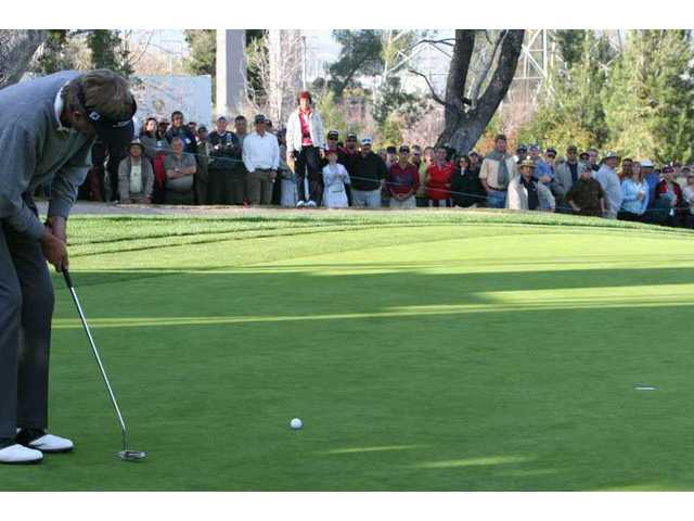 Dan Forsman putts for a birdie in the playoff round with Don Pooley to win the AT&T Champions Classic at Valencia Country Club Sunday.