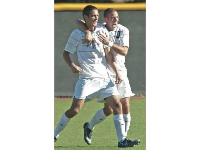 The Mustangs' Joel Peluffo (9), left, and Jake Marchesani (10) celebrate after scoring the first goal against Biola on Saturday at Reese Field. The Master's College clinched the program's first ever Golden State Athletic Conference title with the 2-1 win.