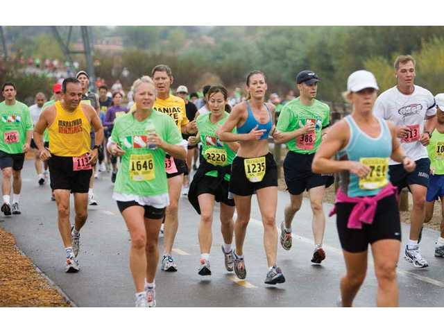 Runners make their way through the paseos during 13th annual Santa Clarita Marathon Sunday morning. More than 3,000 runners participated in Sunday's event.
