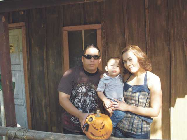 The family of Eric Perez, 2, of Arleta is shown with their pumpkin, which won the 10-and-under category. The judges of the Pumpkin Carving event were Phil Landis of the city of Santa Clarita, Bob Vernon, Santa Clarita resident and a producer and director for Focus on the Family and Scott Sivley, Pumpkin Festival chairman.