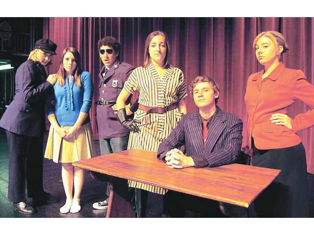 "Students portraying the corporate entities in ""UR IN Town"" include (left to right) Emily Christensen (Barrel), Amanda McWorter (Hope), Matthew Van Der Velde (Lockstock), Michelle Muldoon (Pennywise), Daniel Botello ( Cladwell) and Lillian Proulx (Senator Fipp)."