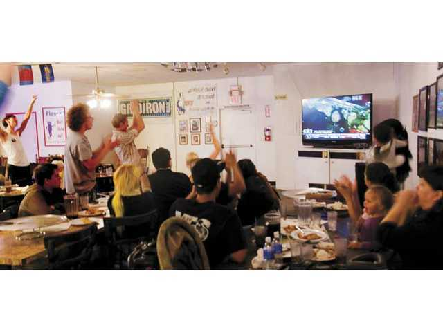 Santa Clarita Valley Democrats celebrate Tuesday night after Sen. Barack Obama wins the race to become the 44th president of the United States. Vincenzo's on Lyons Ave. served as one of three Democratic headquarters in the SCV.