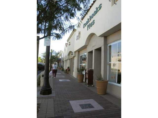 The newly revamped sidewalk runs in front of Cookbooks Plus in Newhall.