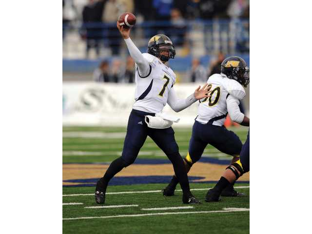 Valencia High graduate and Northern Arizona University quarterback Michael Herrick has thrown for 2,472 yards and 18 touchdowns this season.