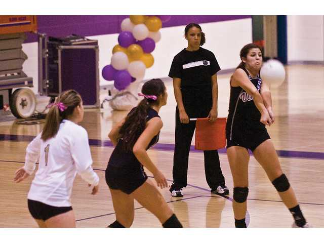 (From left to right) Valencia High's Megan Lavo (No. 1), Shelby LeDuff (No. 17) and  Jayme Pinkowski (No. 5) play against Golden Valley in the first game of the match that Valencia won 25-18.